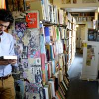 Paper trail: Marco Cremasco of Sao Paulo, Brazil, browses Downtown Books located on the iconic Route 66 in Albuquerque, New Mexico. | AP