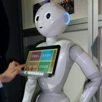 Pushing buttons: A recent report that had SoftBank warning customers not to have sexual relations with its robot, Pepper, may have added to the perception that the Japanese have odd ideas about sex.   KYODO
