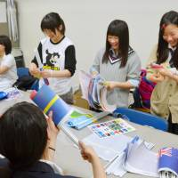 General hospitality: High school students prepare welcome packages for overseas delegates to a summit for Pacific Ocean island nations earlier this year. The packages are a part of Japan's omotenashi culture, which some critics say serves the ego of the host over the desires of the guest. | KYODO