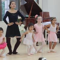 In first position: Miss Vivian Sazuki Baba takes the Poppins after-school ballet class through some basic moves.   DANIELLE DEMETRIOU