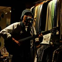 In-store live: A guitarist plays at a small shop called Tatsumakidou in Nagaoka, Niigata Prefecture. Since venues in Tohoku and its surrounding areas are often booked by major acts, indie musicians find other places to make themselves heard. | IAN MARTIN