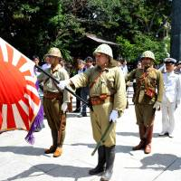 Old stomping ground: Rightists dress as Imperial Japanese Army soldiers as they mark the 69th anniversary of the end of World War II on Aug. 15, 2014, at Yasukuni Shrine in Tokyo's Chiyoda Ward. | YOSHIAKI MIURA