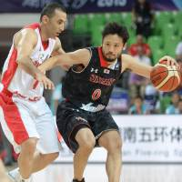 Japan guard Yuta Tabuse drives to the basket against Iran during Saturday's third-place game at the FIBA Asia Championship in Wuhan, China. Iran defeated Japan 68-63. | KYODO