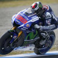 Spain's Jorge Lorenzo steers his Yamaha during the third free practice session for the Japanese Moto GP at the Twin Ring Motegi circuit on Saturday. | AP