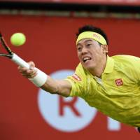 Kei Nishikori hits a return against Sam Querrey during their match at the Japan Open on Wednesday at Ariake Colosseum. | AFP-JIJI