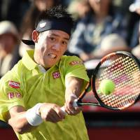 Kei Nishikori plays a shot from Marin Cilic during their quarterfinal match at the Japan Open on Friday at Ariake Colosseum.   AFP-JIJI