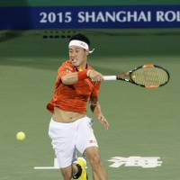 Kei Nishikori hits a return to Kevin Anderson at the Shanghai Masters on Thursday. Anderson defeated Nishikori in the third round, winning 7-6 (12-10), 7-6 (7-3). | KYODO