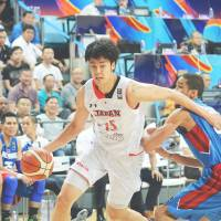 Joji Takeuchi drives to the basket against the Philippines in a semifinal game at the FIBA Asia Championship on Friday in Changsha, China. The Philippines beat Japan 81-70. | KYODO