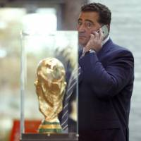 Domenico Scala, chairman of FIFA's audit and compliance committee speaks on his phone after a meeting on Tuesday at FIFA's headquarters in Zurich. | REUTERS