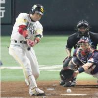 Hawks catcher Hiroaki Takaya, seen batting at Yafuoku Dome on Saturday, rapped out a pair of hits in the opening two games of the Japan Series. | KYODO