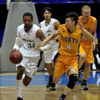 The Tokyo Apache are one of numerous Japan men's basketball teams to fold over the past few decades. In this January 2011 file photo,  Apache guard Kensuke Tanaka defends Damian Johnson of the Oita HeatDevils.  | YOSHIAKI MIURA