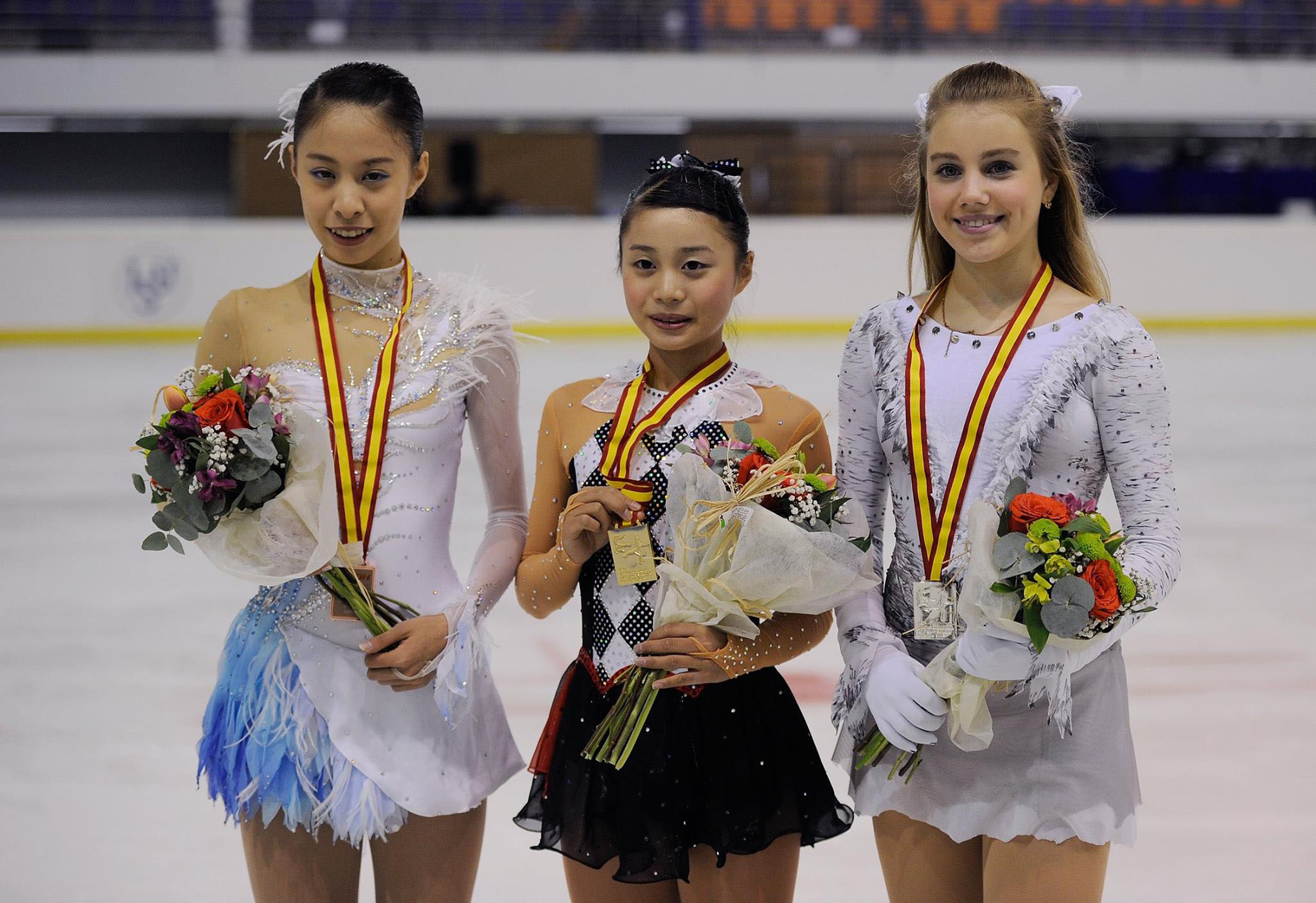 Yuna Shiraiwa (center) poses with her gold medal alongside Yura Matsuda (left) and Russia's Alisa Fedichkina after winning the Junior Grand Prix in Logrono, Spain, on Friday night. | FACEBOOK / ISU