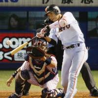 Yomiuri's Hayato Sakamoto hits a two-run home run in the fifth inning of the Giants' 4-1 win over the Swallows in Game 1 of the Central League Climax Series final stage on Wednesday. | KYODO