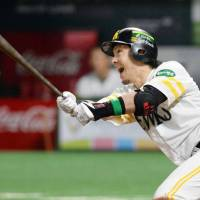 The Hawks' Nobuhiro Matsuda hits a solo home run in the fourth inning against the Swallows in Game 1 of the Japan Series on Saturday night at Yafuoku Dome. Fukuoka Softbank defeated Tokyo Yakult 4-2.   KYODO