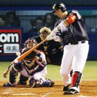 Fukuoka Softbank's Lee Dae-ho hits a double in the third inning of the Hawks' 6-4 win over the Swallows in Game 4 of the Japan Series at Jingu Stadium on Wednesday. | KYODO
