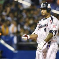 Tokyo Yakult's Wladimir Balentien throws his bat after striking out in the eighth inning of Wednesday's game at Jingu Stadium. | KYODO