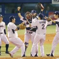 Swallows players celebrate the team's 3-2 triumph over the Giants in Game 4 of the Central League Climax Series final stage on Saturday night at Jingu Stadium. Tokyo Yakult advanced to the Japan Series to take on the defending champion Fukuoka Softbank Hawks. | KYODO