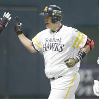 Lee Dae-ho (center) is congratulated by Hawks teammates after hitting a two-run homer in the fourth inning during Game 2 of the Japan Series on Sunday. | KYODO