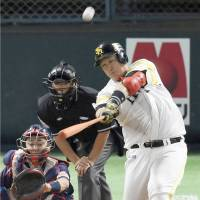 The Hawks' Lee Dae-ho hits a two-run home run in the fourth inning on Sunday. | KYODO