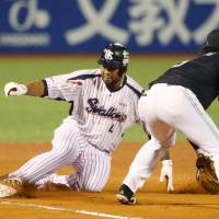 Tokyo Yakult's Wladimir Balentien slides to third during Game 4 of the Japan Series at Jingu Stadium on Wednesday. | KYODO