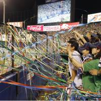 Swallows fans are thrilled to see the Central League team win the pennant for the first time since 2001. | KYODO