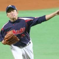 Swallows starter Masanori Ishikawa pitched only four innings in Game 1.   KYODO