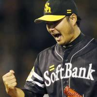 Fukuoka Softbank starting pitcher Tadashi Settsu celebrates during the Hawks' 6-4 win on Wednesday. | KYODO