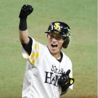 Leadoff man Keizo Kawashima, seen after getting a hit in the pivotal fourth inning, and his Hawks teammates pounded out 15 hits in a Game 1 victory on Saturday.   KYODO