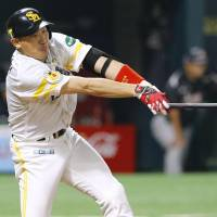 The Hawks' Seiichi Uchikawa smashes a go-ahead double in the sixth inning against the Marines in Game 2 of the Pacific League Climax Series final stage on Thursday at Yafuoku Dome. Fukuoka Softbank defeated Chiba Lotte 6-1. | KYODO