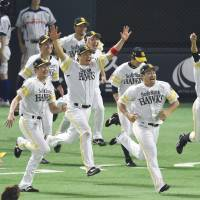 The Fukuoka Softbank Hawks celebrate their return to the Japan Series after eliminating the Chiba Lotte Marines with a 3-1 victory on Friday in Game 3 of the Pacific League Climax Series final stage at Yafuoku Dome. The Hawks swept their PL rival in the series. | KYODO