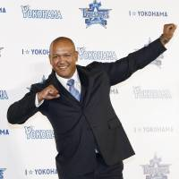 BayStars manager Alex Ramirez poses for pictures during his introductory news conference on Wednesday.   KYODO