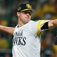 Hawks starter Rick van den Hurk delivers a pitch in Game 2 of the Pacific League Climax Series final stage on Thursday. | KYODO