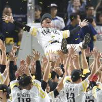 Hawks manager Kimiyasu Kudo is tossed in the air on Friday night after his club clinched a spot in the Japan Series. | KYODO