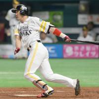The Hawks' Seiichi Uchikawa hits a two-out single in the third inning to break a scoreless tie. | KYODO