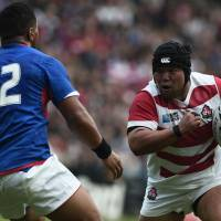 Japan prop Kensuke Hatakeyama runs with the ball during Saturday's win over Samoa at the Rugby World Cup. | AFP-JIJI