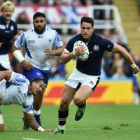 Scotland's Matt Scott runs with the ball during his team's win over Samoa at St. James' Park in Newcastle, England, on Saturday. | AFP-JIJI