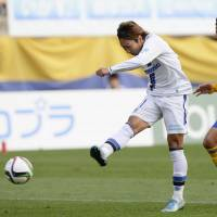 Shu Kurata scores in Gamba Osaka's 3-1 away win over Vegalta Sendai in the J. League on Sunday. | KYODO