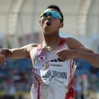 Abdul Hakim Sani Brown burst onto the scene with some impressive results on the track this summer. Sani Brown is one of a growing number of biracial Japanese athletes. | KYODO