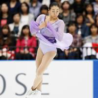 Mao Asada performs a jump during the Japan Open on Saturday. | KYODO