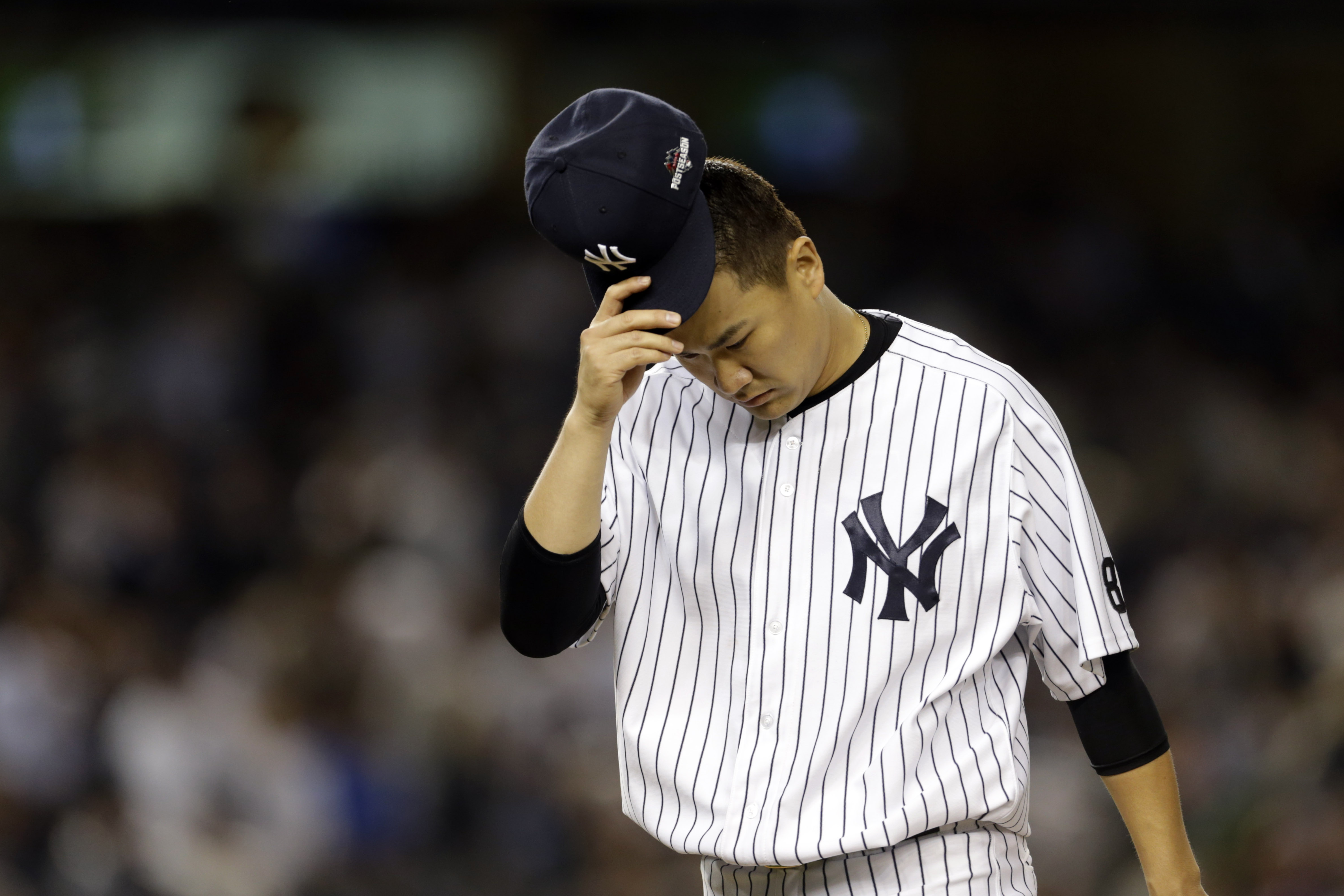 Yankees starter Masahiro Tanaka reacts after the second inning of the AL wildcard game at Yankee Stadium.   USA TODAY / REUTERS