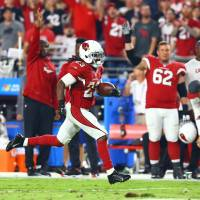 Johnson, Cards get past Ravens