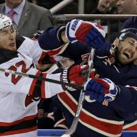 Devils give coach Hynes first win