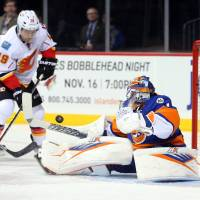 Halak turns aside 29 shots to extinguish Flames