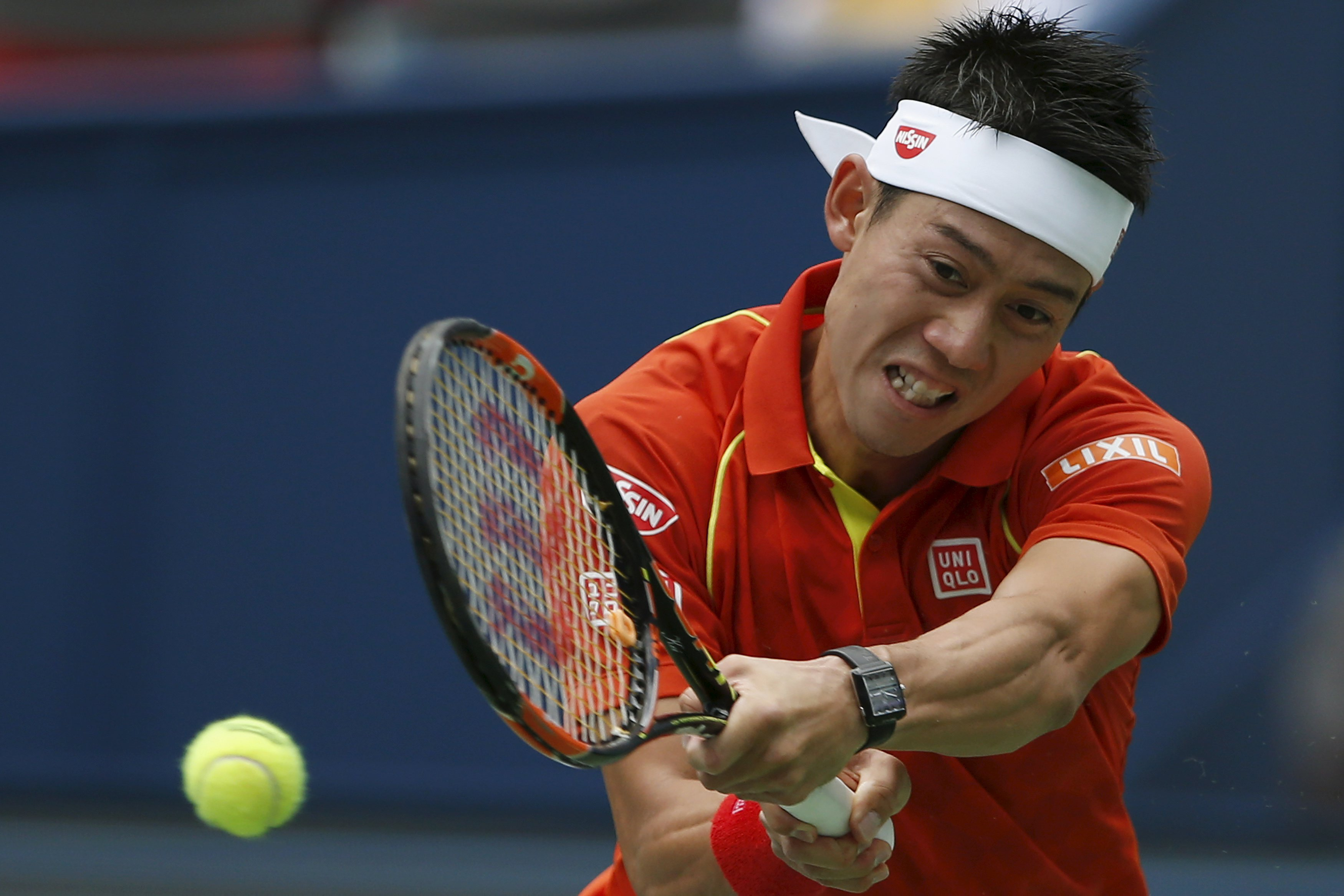 Kei Nishikori hits a shot during his match against Nick Kyrgios of Australia at the Shanghai Masters on Wednesday. | REUTERS