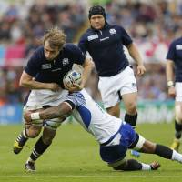 Scotland's Jonny Gray takes on the Samoa defense at St. James' Park in Newcastle, England, on Saturday.   REUTERS