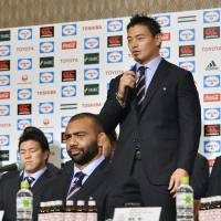 Japan rugby star Ayumu Goromaru, surrounded by teammates, speaks during a Tuesday news conference after the Brave Blossoms' return following the Rugby World Cup. Japan triumphed in three of four games in England. | KYODO