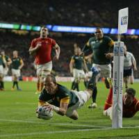 South Africa's Fourie Du Preez scores a try during the Springboks' 23-19 win over Wales in their Rugby World Cup semifinal at Twickenham on Saturday. | AP