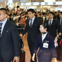 Japan rugby national team members arrive at Haneda airport on Tuesday after the Brave Blossoms' successful Rugby World Cup campaign. Japan won three of four matches in England, but missed out on advancing out of pool play. | KYODO