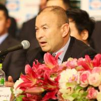 Japan coach Eddie Jones addresses the media on Tuesday after the team's return from the Rugby World Cup in England. | KAZ NAGATSUKA