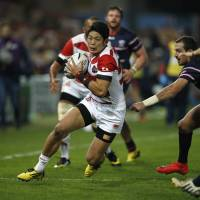 Japan's wing Yoshikazu Fujita runs with the ball during the final Pool B match of the 2015 Rugby World Cup against the U.S. on Sunday at Kingsholm Stadium in Gloucester, England. | AFP-JIJI